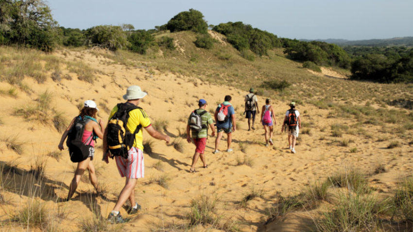 Hiking over sand dunes at Kosi Bay Mouth